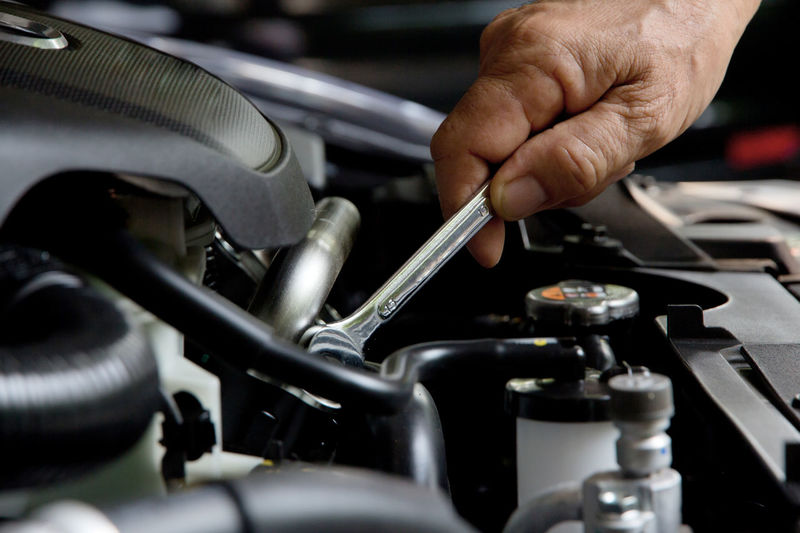 auto repair concept Automobile Auto Auto Repair Shop Car Car Engine Close-up Day Engine Holding Human Body Part Human Hand Indoors  Maintainance Maintenance Work Occupation One Person People Repairman Transportation