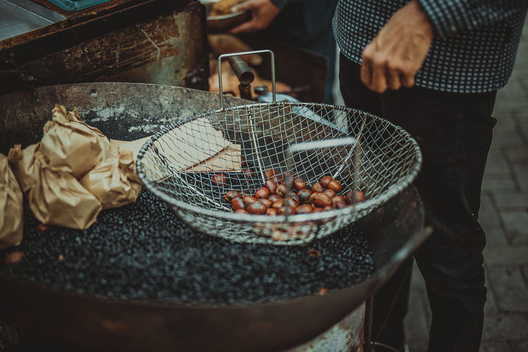 Barbecue Grill Container Day Food Food And Drink Freshness Hand Heat - Temperature Human Body Part Human Hand Incidental People Men Midsection One Person Outdoors Preparation  Preparing Food Real People Selective Focus Standing