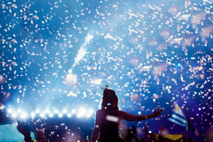 Celebration Event Fireworks Fun Growing Night Lights Rear View Silhouette Arts Culture And Entertainment Celebration Event Crowd Enjoyment Excitement Exploding Firework - Man Made Object Firework Display Iluminated Leisure Activity Lifestyles Men Night Nightlife Outdoors Performance Real People