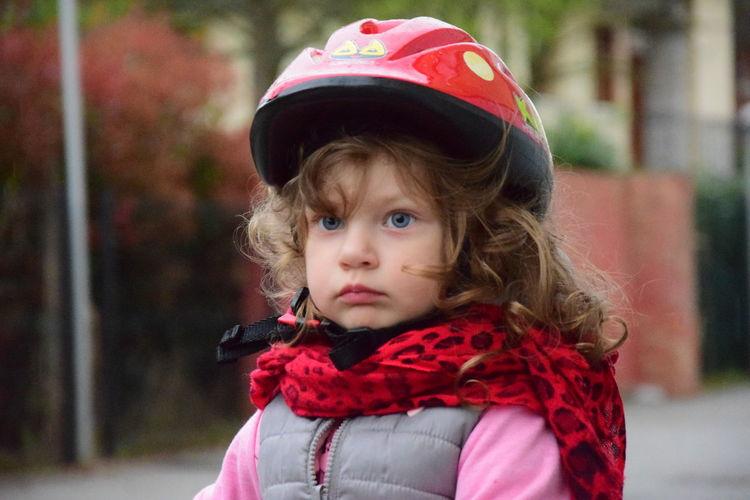 Cute girl wearing helmet looking away