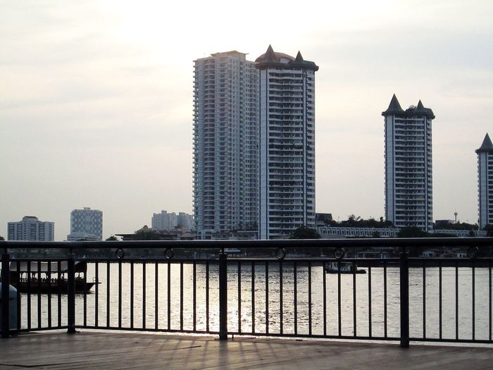 Silhouettes Of A City Taking Photos ,Enjoy The River, Chao Phaya River Sawasdee World. .