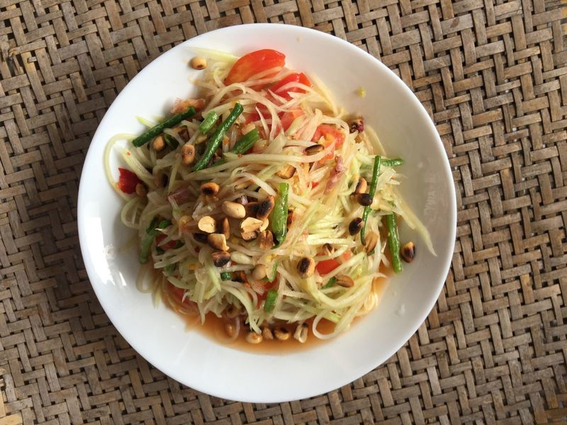 Thai spicy papaya salads or somtum Lunch Dish Tomato Delicious Spicy Food Thai Food And Drink Table Wellbeing Salad Meal Vegetable
