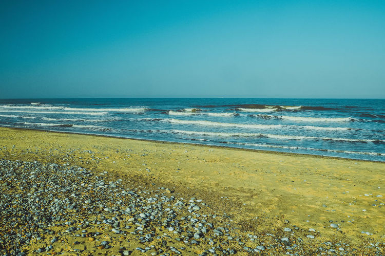 Sea Beach Water Horizon Horizon Over Water Land Sky Scenics - Nature Beauty In Nature Clear Sky Nature Tranquil Scene Tranquility Outdoors Beach Photography Sand Space For Text Space For Copy Motion Leading Lines Blue Wave No People Day Idyllic Pebble