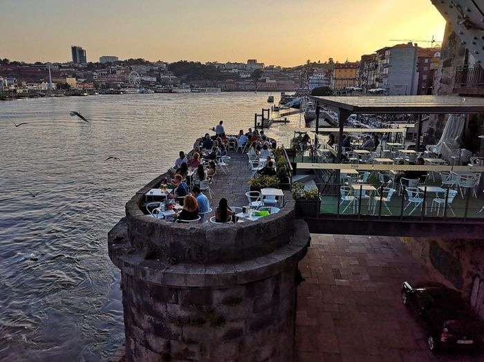 River Sky Nature Water Architecture Built Structure Incidental People Building Exterior Sunset Group Of People City Day Large Group Of People Outdoors High Angle View Travel Destinations
