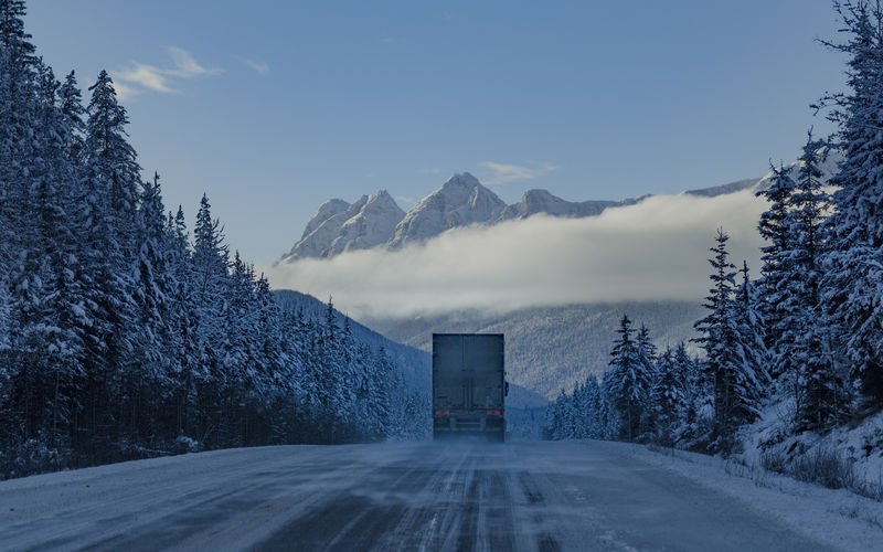 Winter conditions up in a mountain pass This shot was taken driving west down from the Rockies heading back to BC. Jasper National Park, Alberta, Canada Love Life, Love Photography Frozen Ice Truck Beauty In Nature Canada Cloud - Sky Cold Temperature Day Land Vehicle Mode Of Transportation Mountain Mountain Range Nature No People Plant Road Scenics - Nature Sky Snow Snowcapped Mountain The Way Forward Transportation Tree Truck Trucking Winter