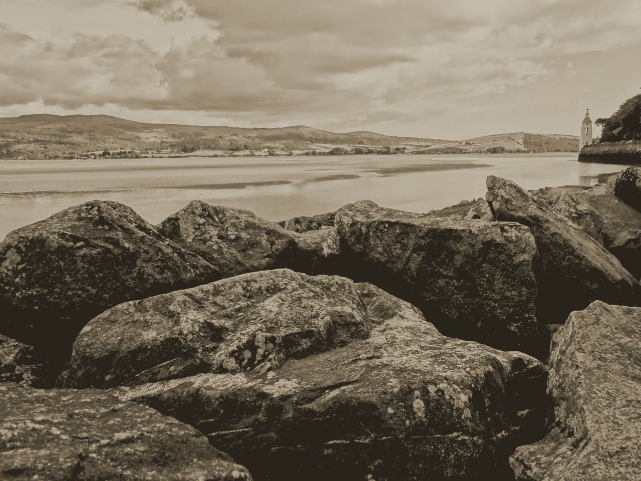 rock - object, sea, nature, water, beach, beauty in nature, tranquility, outdoors, rock, no people, scenics, tranquil scene, pebble, day, sky, pebble beach, horizon over water, groyne