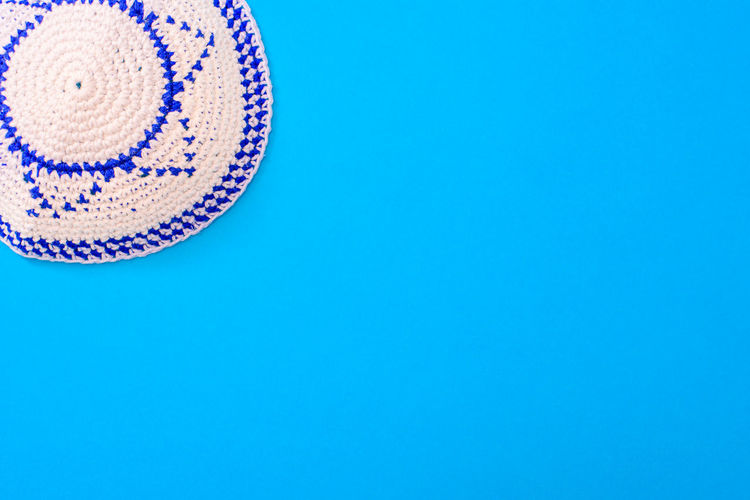 High angle view of hat against blue background