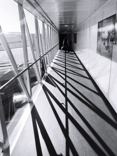 Real People Walking Men Lifestyles Full Length Built Structure Architecture Indoors  Women Leisure Activity Shadow Day Modern Adults Only Adult People Only Men Heathrow Airport Transportation Plane London U.K. Blackandwhite Travel Destinations Traveling