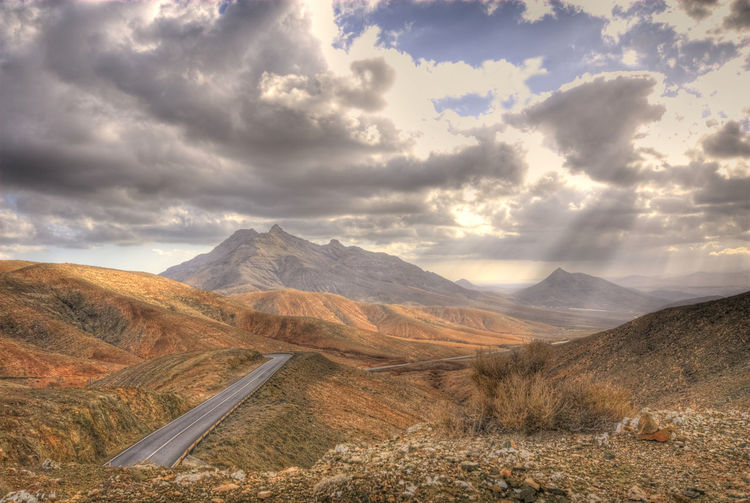 Beauty In Nature Cloud - Sky Day Landscape Mountain Mountain Range Mountain Road Nature No People Outdoors Physical Geography Scenics Sky Sun Rays Tranquil Scene Tranquility Winding Road