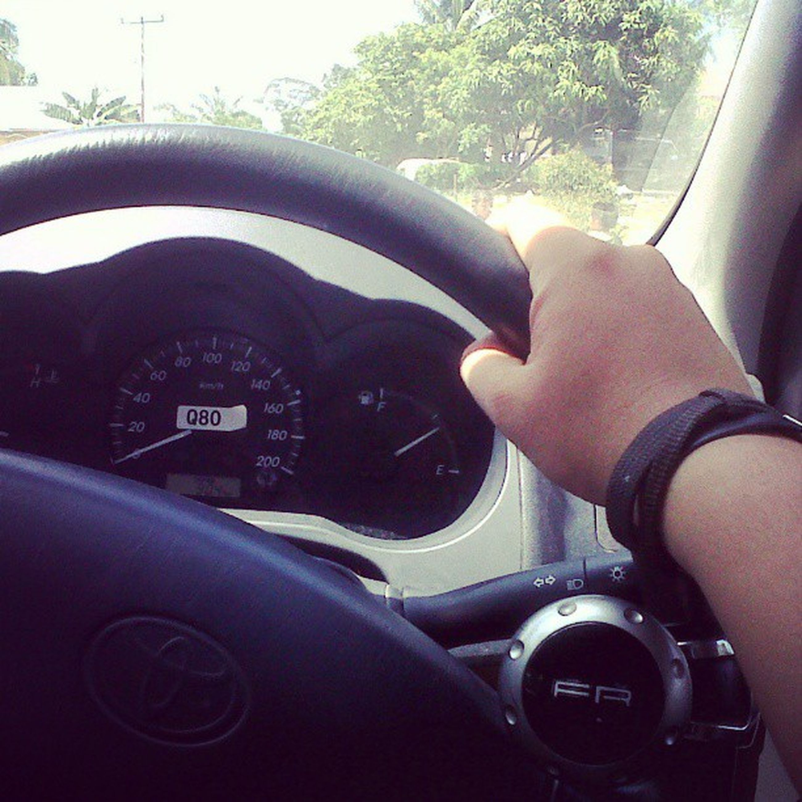 transportation, mode of transport, land vehicle, car, vehicle interior, travel, car interior, lifestyles, part of, leisure activity, driving, windshield, personal perspective, men, cropped, steering wheel, on the move