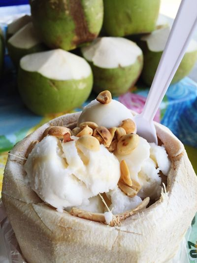 Close-up of coconut ice cream with peanuts