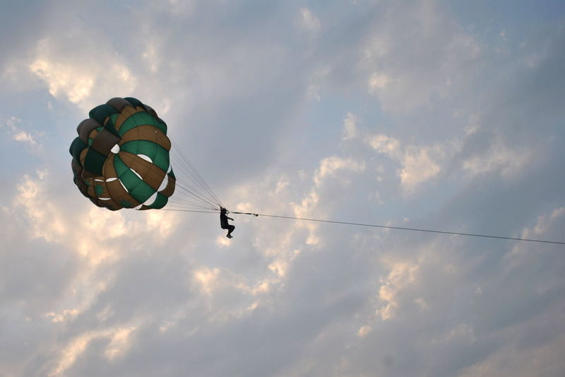 Adventure Beauty In Nature Blue Cloud Cloud - Sky Cloudy Day Freedom Fun Hot Air Balloon Leisure Activity Lifestyles Low Angle View Mid-air Multi Colored Nature Outdoors Paragliding Scenics Sky Tranquility