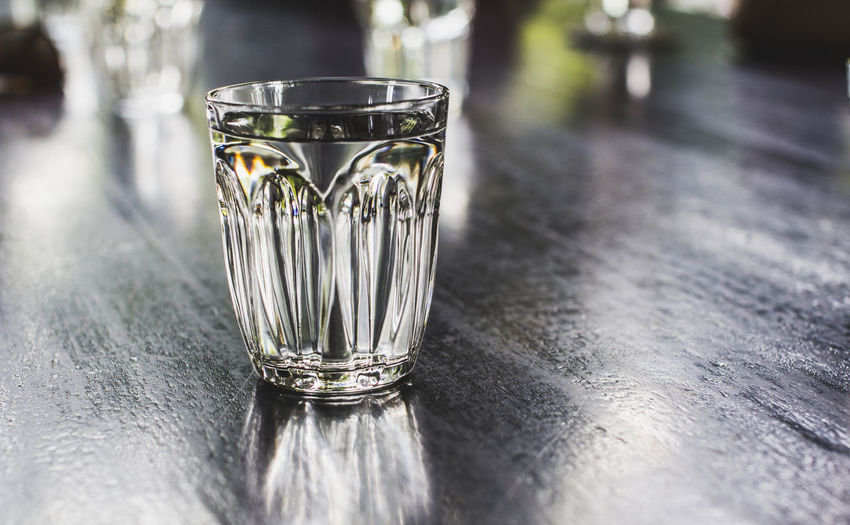Water glass on table