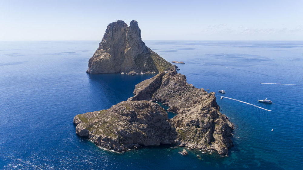 Beautiful Nature Drone  Es Vedrá From Above  Ibiza Lost In The Landscape SPAIN Aerial Aero Bluewater Boats Clear Sky Cliff Day Dronephotography Horizon Over Sea Horizon Over Water Landscape Nature No People Rock - Object Sea Sea And Sky Sky Water