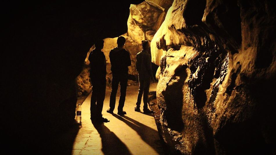 The brightest flame casts the darkest shadow. (PC:bhagyaraju gowdra) Rock - Object Adventure Cave People Men Togetherness Nature Open Air Vizag City Nature Outdoors Multiple Exposures Quality Time FreeTime Shadow Shadows & Lights Blackandwhite Orange Color Explosion Of Colors