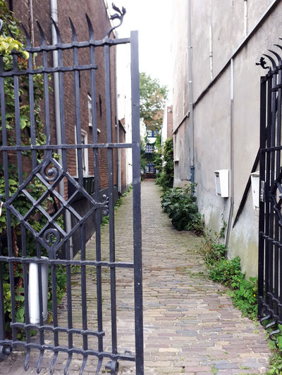 Gate Residential District Dunne Bierkade The Hague, The Netherlands Architecture No People Metal Fence Footpath Entrance Wrought Iron Alley EyeEmNewHere