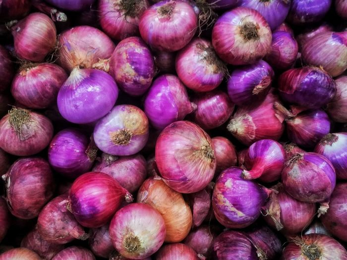 the onion background. Onions Backgrounds Full Frame Purple Market Vegetable Close-up For Sale Farmer Market Display Market Stall Window Display Collection Street Market Flower Market Fish Market Variety Variety Price Tag Raw Shop Various Stall Heap Retail Display