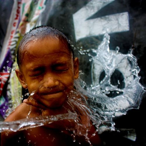 water kid Broformyphotog Shutterspeedpriority Water Hot Summer Day Creatures Brown Street Canonphotography Canon Kid Children Play Shutter Illgrammers Grammer Face Quezoncity Philippines