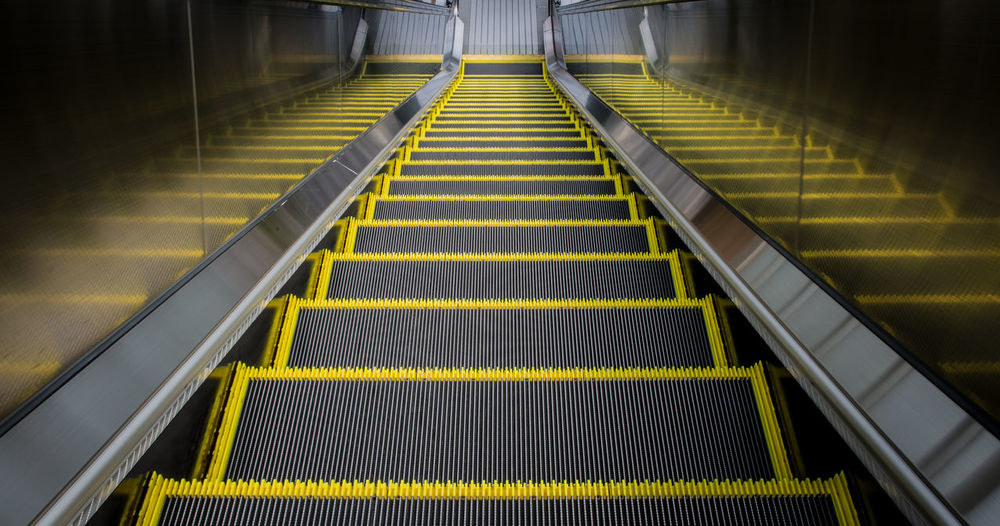 escalator Mishima Architecture Convenience Day Direction Escalator Futuristic High Angle View Illuminated Indoors  Modern No People Railing Staircase Steps Steps And Staircases Subway Station Technology The Way Forward Transportation Yellow