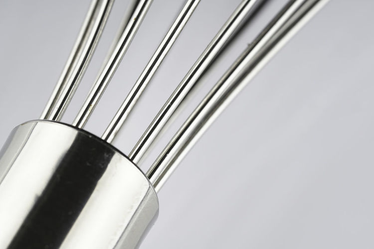 Low angle view of metal against white background