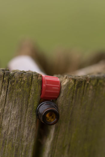 Traces Of Neglect And Dissolution Alcohol Close-up Day Drained Bottles Get Heavier Gap Misplaced No People Outdoors Red Underberg Wood - Material Wooden Post