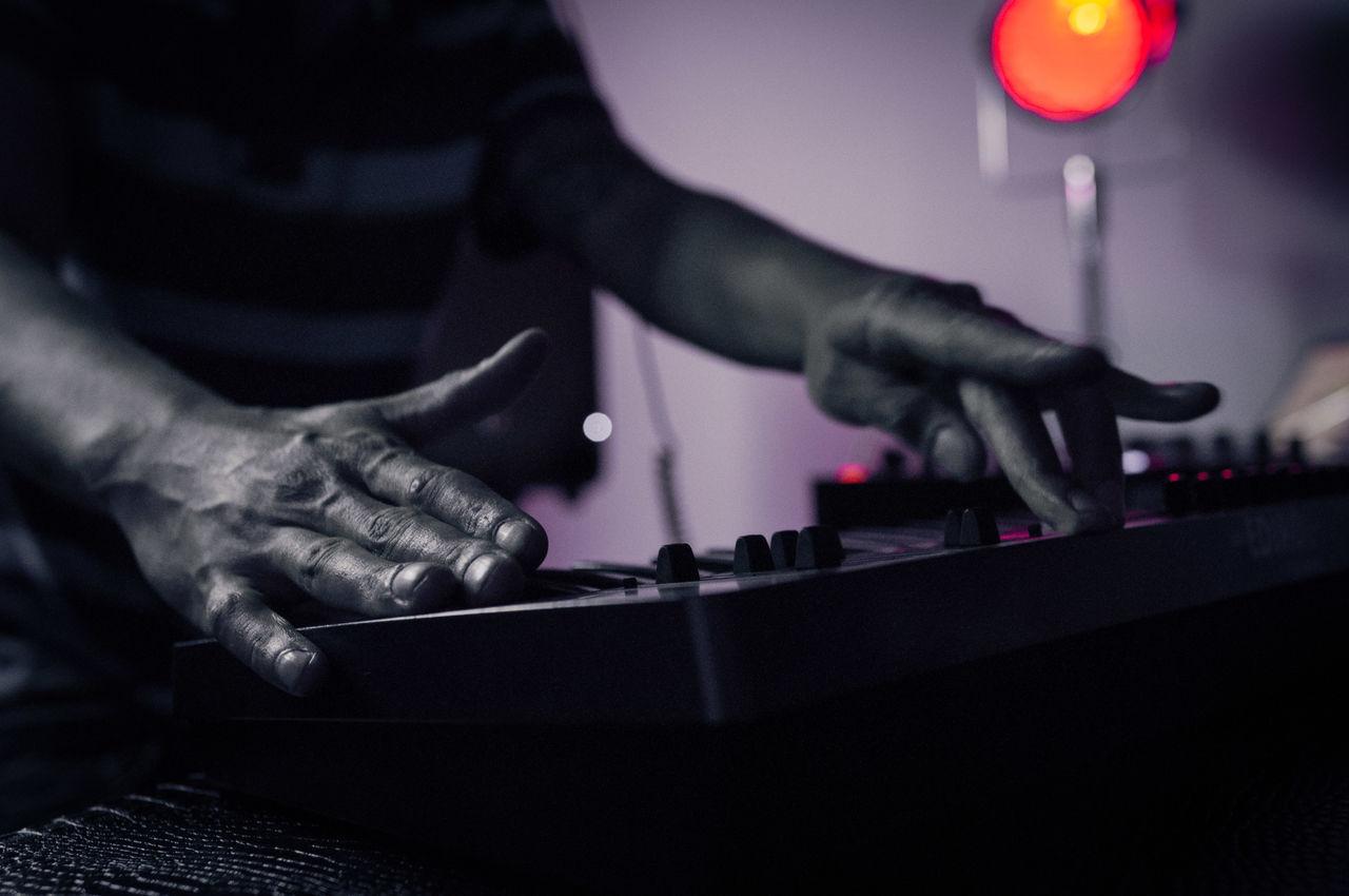 Dj operating a sound mixer