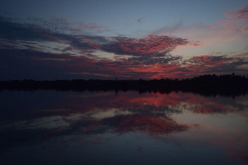 Reflection Water Sunset Red Lake Sky Nature Day Eyeemawards16 Eyeemawards2016 EyeEm Cloudy Sky Landscape EyeEm Gallery Sunlight Longexposure Slowspeedphotography Dramatic Sky Light And Shadow
