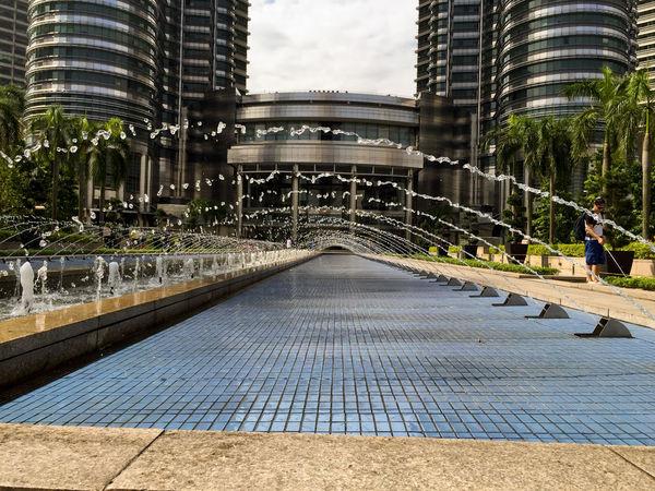 Petronas Kualalumpur Fooling Around Water Malaysia water arch at Petronas towers