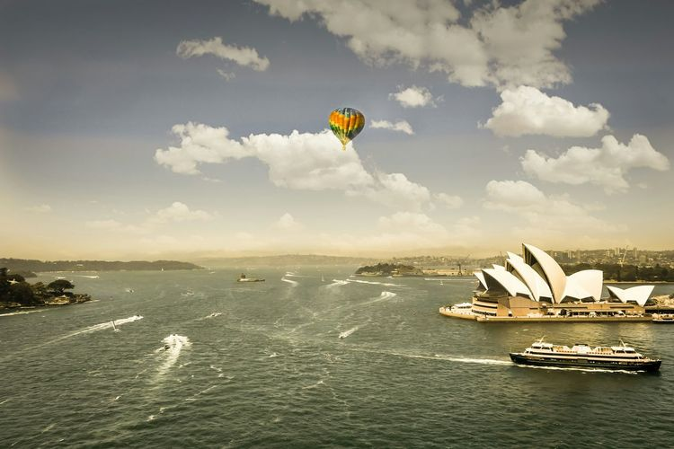High Angle View Of Sydney Opera House On Sea Against Sky