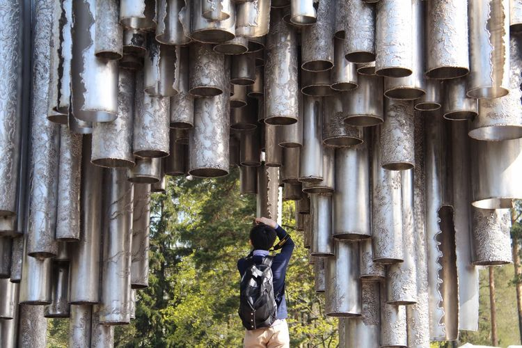 Rear View Of Man Photographing Sculpture At Sibelius Monument