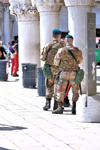 Protecting the public Anti Terrorism Antiterrorism Architectural Column Army Camouflage Casual Clothing City Life Day Full Length Guard Guarding Guards Italy Leisure Activity Lifestyles Outdoors Patrol  Patrolling Police Safety Security Terrorism Uniform Venezia Venice