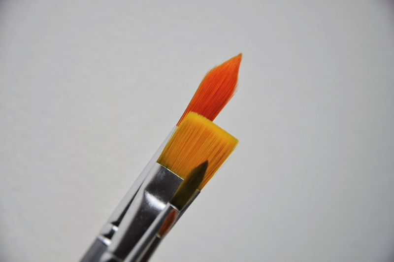 Close-up of pencil over white background