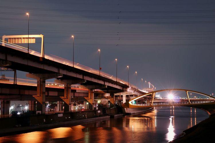 Bridges over river at night