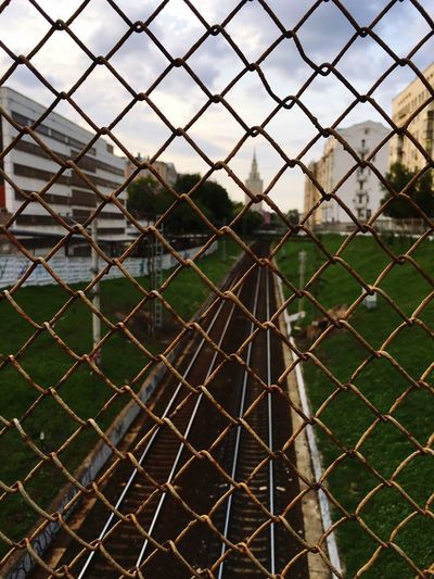 Fence Chainlink Fence Security Protection Safety Metal Security System Prison Rusty No People Outdoors Day Playing Field Full Frame Backgrounds Close-up Prisoner Sky Military Nature