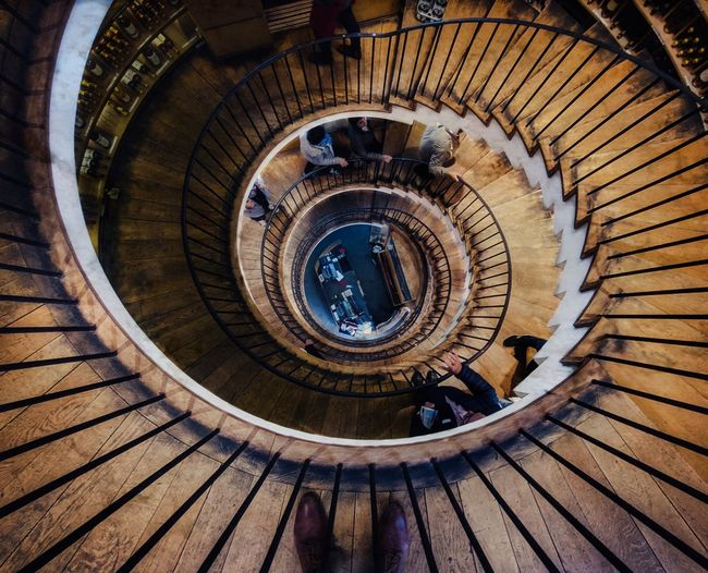 round and round EyeEm Gallery Eye4photography  Spiral Staircase Stairs Steps And Staircases Spiral Steps High Angle View Staircase Spiral Stairs Railing Architecture Hand Rail Ceiling Light  Finger Ring Concentric Narrow Star Trail Splashing Droplet Architectural Design Architectural Detail Architectural Feature