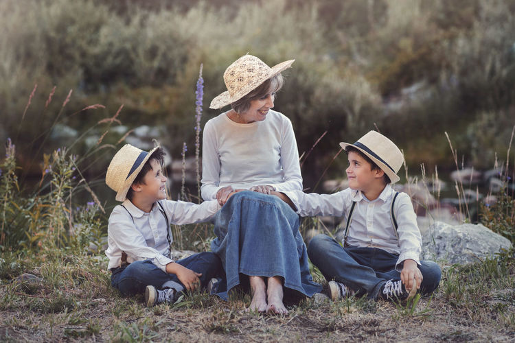 Children Complicity Family Grandchildren Happiness Innocence Lifestyle Love Loving Union Boys Caring Child Childhood Family Field Friendship Generations Grandmother Happiness Hat Real People Senior Women Sitting Spring
