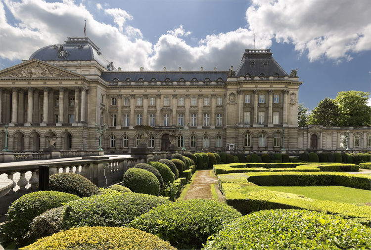 Brussels, Belgium. May 3, 2018: Views of the Royal Palace and its gardens in the Belgian capital. Belgium Brussels Place Travel Architecture Building Exterior Built Structure Bush Cloud - Sky Day Formal Garden Garden Gardens Grass Green Color Hedge History Mansion Nature No People Outdoors Plant Royal Palace Sky Travel Destinations