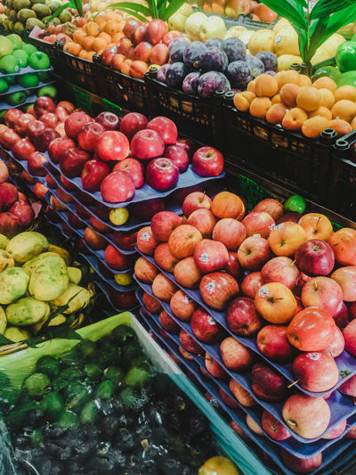 High angle view of red fruits for sale in market