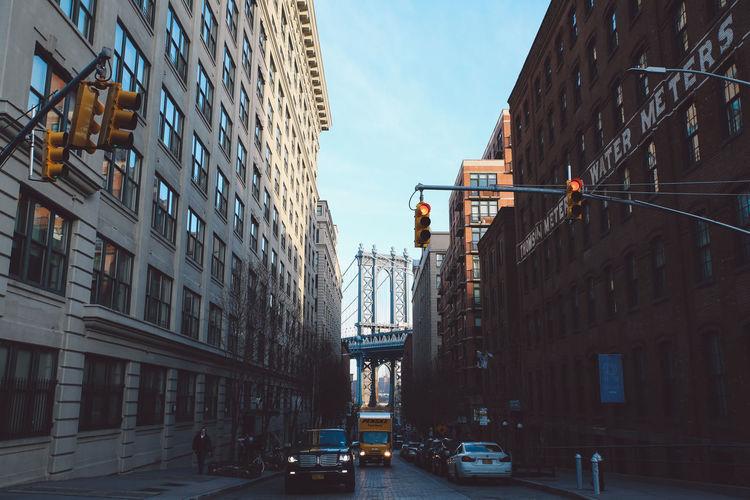Cars On City Street Against Sky