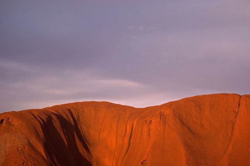 Sky Scenics - Nature Beauty In Nature Tranquility Tranquil Scene Non-urban Scene Desert Cloud - Sky Landscape Mountain Environment Physical Geography Remote Climate No People Nature Arid Climate Geology Idyllic Day Outdoors Formation Uluru Australia Indigenous