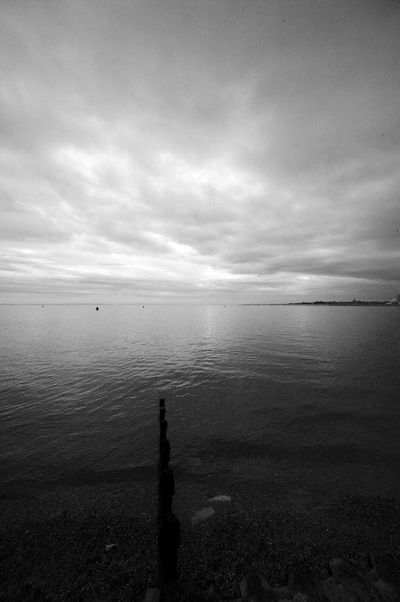 Pointing The Wrong Way Water Sky Cloud - Sky Sea Scenics - Nature Tranquil Scene Tranquility Nature Horizon Horizon Over Water No People Beach Post Wooden Post Blackandwhite Black And White