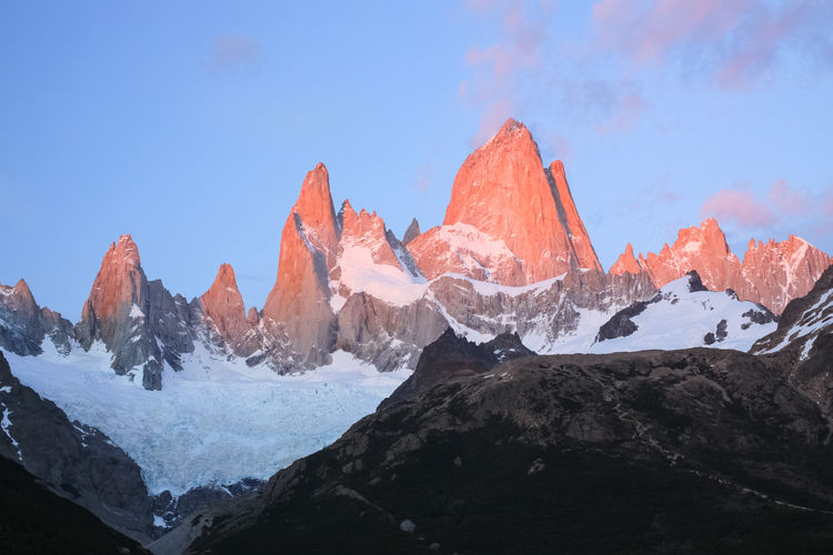 Alpenglow on a very very cold pre dawn on the Fitzroy Massif. Left to right the main peaks are Aguja de la S (2335m), Saint Exupery (2558m), Aguja Rafael (2482m), Cerro Poincenot (3002m), Aguja de la Silla (2938m), Monte Fitz Roy (3405m), Aguja Val de Vois (2653m), Aguja Mermoz (2732m). Argentine Patagonia, Argentina Love Life, Love Photography Alpenglow Argentina Beauty In Nature Dawn Day Fitzroy Glacier Iceberg Landscape Massif Monte No People Outdoors Patagonia Pink Scenics Sky Snow Sunrise Tranquil Scene Tranquility Rock Ice Cold Peaks