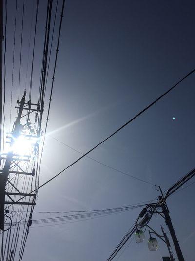 今日の昼間の空 空 Sky 青空 Blue Sky 電線 Electric Wires 電柱 Utility Pole 太陽 Sun