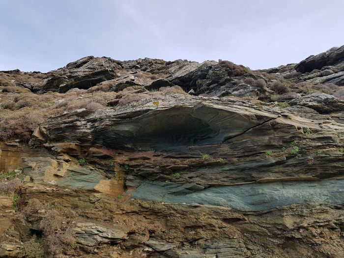 Geological Strata Feature Plant Life Stone Greek Islands Outdoors No People Strata  Layers Erosion Geology Mountain Arid Climate Desert Extreme Terrain Cold Temperature Sky Landscape Physical Geography Volcanic Activity Rugged Eroded Dramatic Landscape
