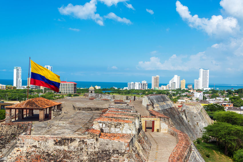 View of San Felipe de Barajas castle and the skyline of Cartagena, Colombia with a large Colombia flag Ancient Architecture Building Caribbean Cartagena Cartagena De Indias Castillo Castle Cityscape Colombia Colombian  Colonial Colonial Architecture Defense Flag Fort Fortification Landmark Latin Nation San Felipe De Barajas Stone Symbol Walls Wind