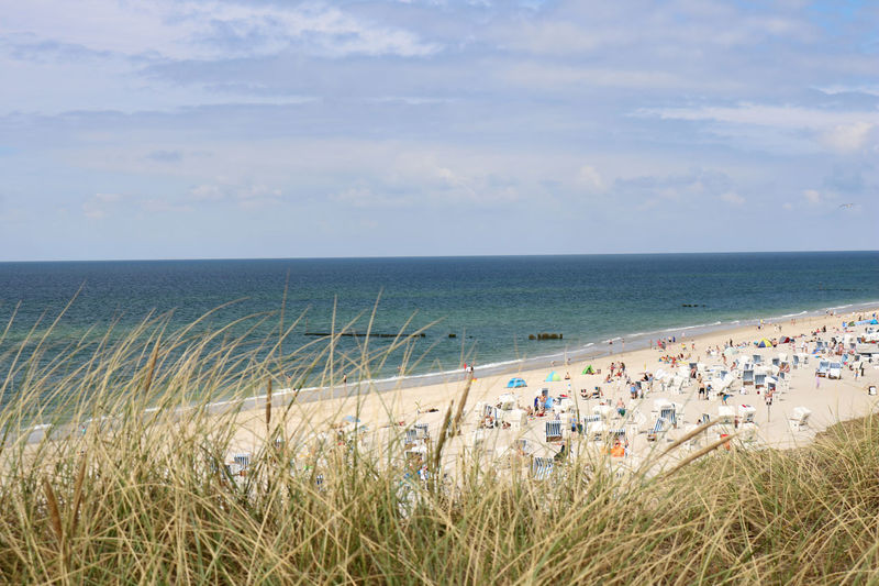 Kampen beach on Sylt island, Germany, on a sunny summer day. Dunes High Season Kampen View Beach Day Germany Grass Group Of People Holiday Horizon Indirect Land Nature North Sea Ocean Outdoors Popular Sand Scenics - Nature Sea Sky Summer Sylt Water