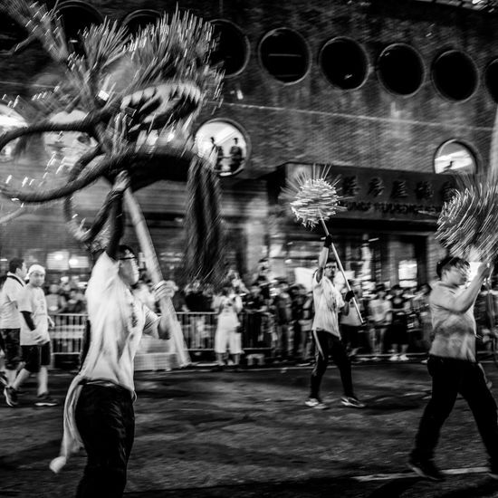 Monochrome Hkbw Nightshooters Reframinghk Artisanandartist Discoverhongkong Building Exterior Built Structure Real People Architecture Group Of People City Men Women Lifestyles Leisure Activity Motion People Night City Life Adult Street Blurred Motion Outdoors Tree