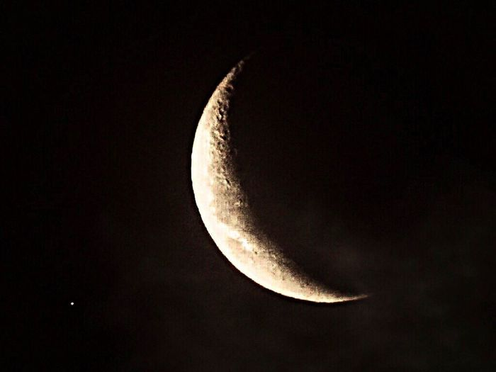 Low angle view of half moon against sky at night