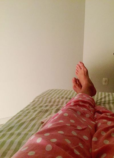 Interior Views Bedroom Bed Bed Time resting Bedsheet Stripes Pattern Pajama Pajama Balls Room Feet View Legs