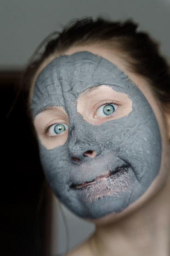 Portrait Of Young Woman Wearing Facial Mask